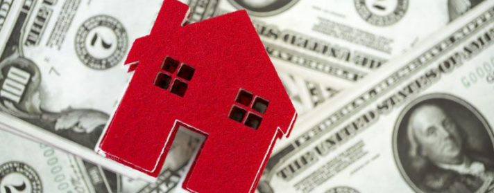 red home cutout on pile of money, should you invest in high-value home coverage?